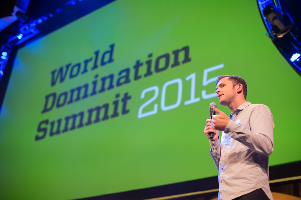 Chris Guillebeau in a photo appearing in a post called Who Were The Best World Domination Summit 2015 Speakers? written by Haydee Montemayor from the Love and Treasure blog which you can find by visiting www.loveandtreasure.com in order to get a review of the World Domination event hosted by Chris Guillebeau